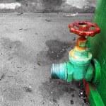 Rusty valve on industrial tank — Stock Photo