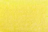 Yellow sponge texture of scouring pad — Stock Photo