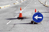 Road detour sign and cones due pothole — Stock Photo