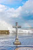 Stone cross in memory of deceased sailors — Stock Photo