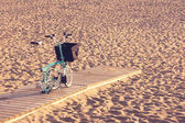 Four wheel bicycle on beach — Photo