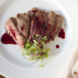 Skirt Steak with Pomegranate Gastrique — Photo