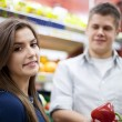 Young couple shopping at groceries — Stock Photo #21816609