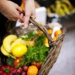 Basket filled healthy food - Foto Stock