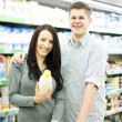 Young couple shopping at supermarket — Stock Photo #21818013