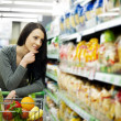 Woman at groceries store — Stock Photo #21818573