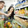 Couple at supermarket — Stock Photo #21818599
