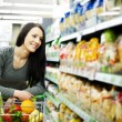 Woman at groceries store — Stock Photo #21818987