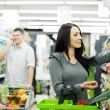Couple at supermarket - Stock Photo