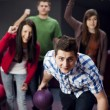 Friends bowling together — Stock Photo