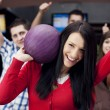 Friends bowling together — ストック写真