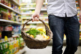 Basket filled healthy food — Stock Photo
