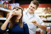 Man suprising his girlfriend — Stock Photo