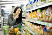 Woman at groceries store — Stock Photo