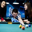 Friends playing billiard — ストック写真