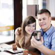 Couple taking picture in cafe — Stock Photo