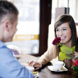Young man giving a rose his girlfriend - Stock Photo