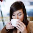 Close up of woman drinking coffe — Stock Photo #21824841