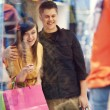 Royalty-Free Stock Photo: Young couple during shopping