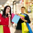 Young woman spending too much money for shopping — Stock Photo