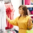 Young woman shopping for clothes — Stock Photo