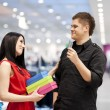 Man spoiling his girlfriend by buying her new clothes — Stock Photo
