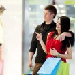 Young couple during shopping — Stock Photo
