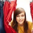 Stock Photo: Hide and seek at clothing store