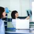 Young woman and doctor watching x-ray — Stock Photo #21828451