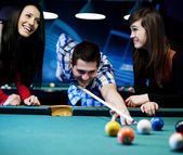 Friends playing billiard — Stock Photo
