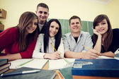 Friends in the classroom — Stock Photo