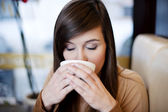 Close up of woman drinking coffee — Stock Photo