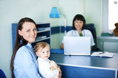 Mother and her daughter at the pediatrician — Stock Photo