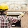 Construction worker pointing at something — Stock Photo #21833011