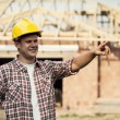 Construction worker pointing at something — Stockfoto