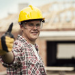 Construction worker gesturing thumbs up - Stok fotoğraf