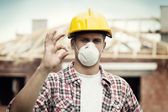 Manual worker with hard hat and protective mask — Stok fotoğraf