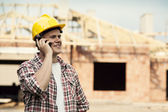 Construction worker with mobile phone — Stock Photo