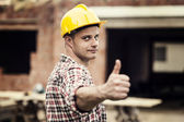 Construction worker gesturing thumbs up — Stock Photo