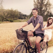 Couple have fun riding on bike — Stock Photo
