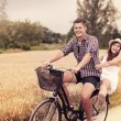 Couple have fun riding on bike — Stock Photo #21840997