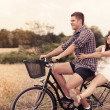 Couple have fun riding on bike — Stock Photo #21841199