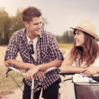 Portrait of happy couple on bicycles — Stock Photo #21841301