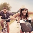 Happy couple racing on bikes - Stockfoto