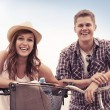 Beautiful couple with bikes — Stok fotoğraf