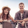 Beautiful couple with bikes — Stock fotografie