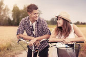 Portrait of happy couple on bicycles — Stock Photo