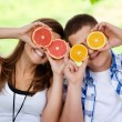 Stock Photo: Young couple having fun with fruits