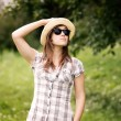 Woman wearing fedora hat and sunglasses — Stock Photo