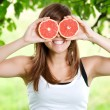 Stock Photo: Womhaving fun with fruits